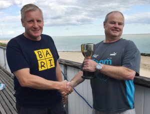 Paul Stanton (right) receives the Double Dan Trophy from last year's winner Brian Allen