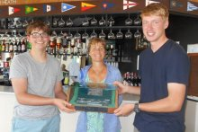 "Tom and Finlay - the ""Two Salty Nuts"" are presented with the Splash Winners Trophy by Cadet Officer Claire Aylen"