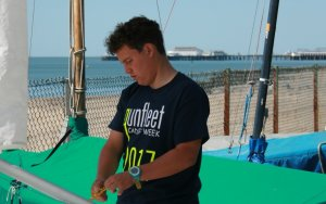 Cadet Commodore Harry Swinbourne rigging his boat ready for racing at Gunfleet
