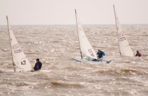 Lively conditions surround the top three sailors in the race for the Toppo Trophy. From left to right - Rob Lockett, Andy Dunnett, and Ken Potts