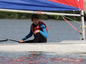 Cadet Ted Newson, in his Topper, takes on the might of the faster boats