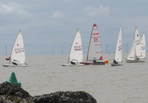 On a close start line, Ken Potts leads the fleet away in his Laser