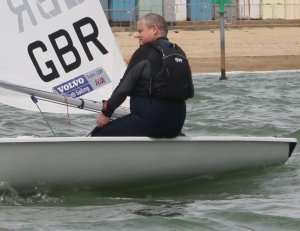 Paul Stanton takes his Laser to victory after a hard fought sail against his competitors