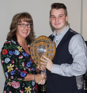 Junior Leading Helm Michael Gutteridge receives the Spirit of the Wind Shield