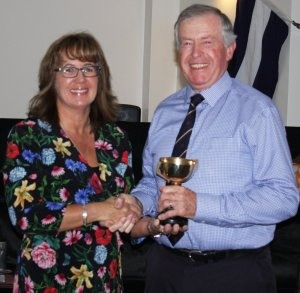 Malcolm Jolly is awarded the Gentlemen's Merit Trophy for services to the Club