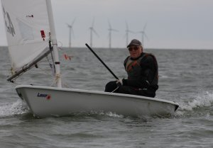 Senior sailor Eddie White sails his Laser through to second place