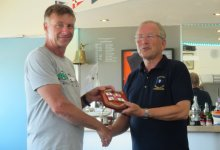 John Tappenden, left, receives his RNLI Shield for winning the Clacton Lifeboat race from Club Commodore Richard Walker