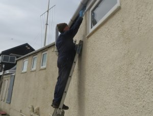 Roy up the ladder with the paint